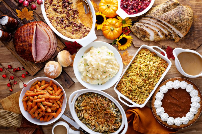 a table full of Thanksgiving side dishes
