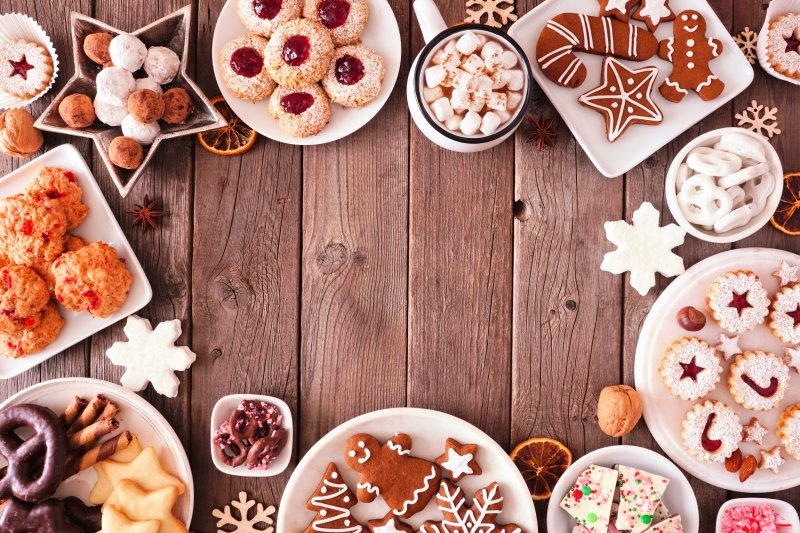 a table full of holiday cookies and treats